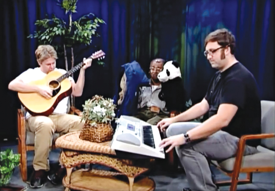 Tim Heidecker (left) and Eric Wareheim (right) accompany amateur puppeteer David Liebe Hart on an episode of <i>Tim and Eric Awesome Show, Great Job!</i>