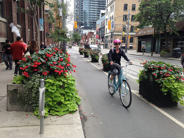 Colorful planters add beauty—and protection—to a bike lane on Adelaide Street.