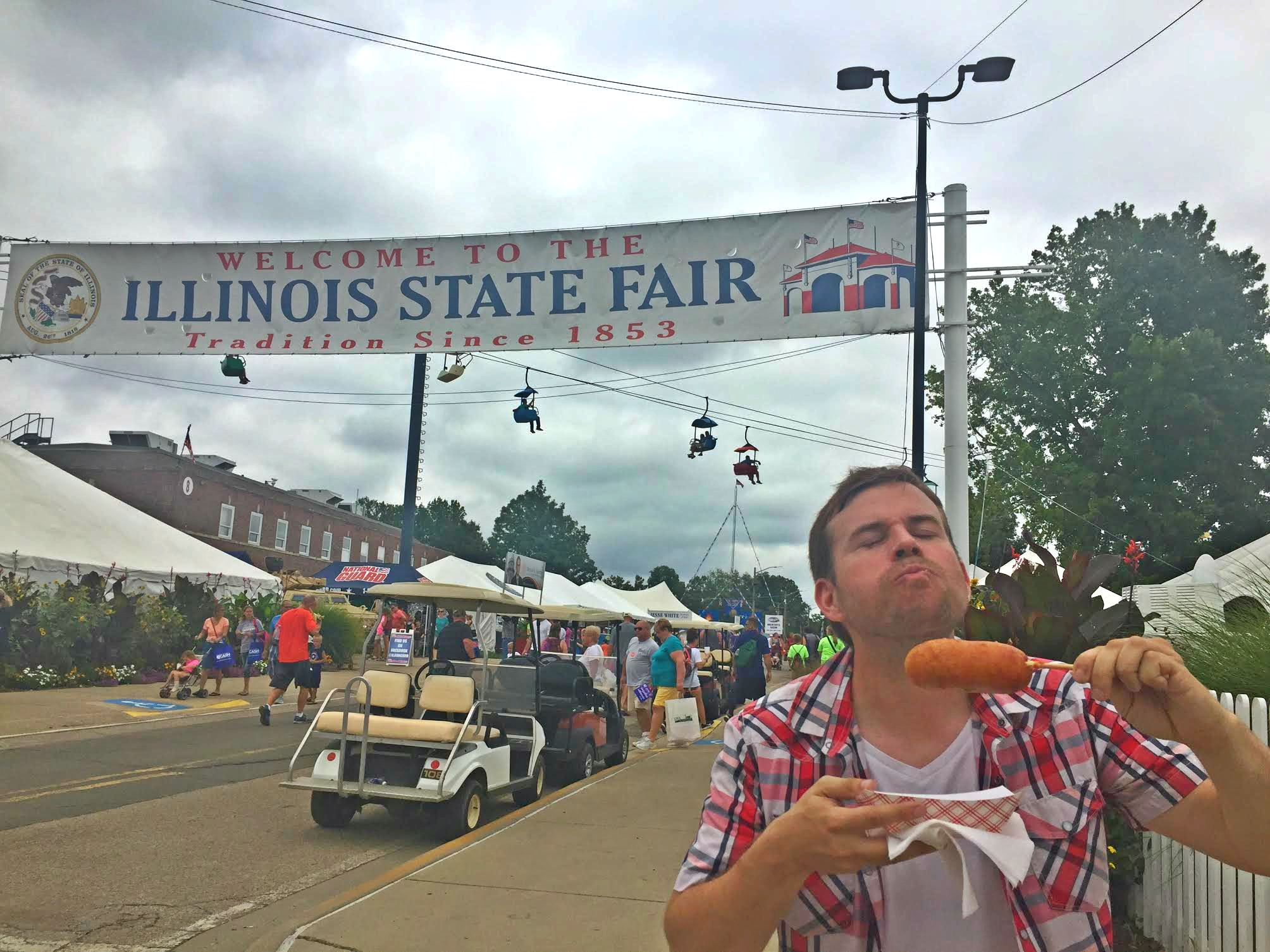 The author savors his first bite of a deep-fried Twinkie at the Illinois State Fair.