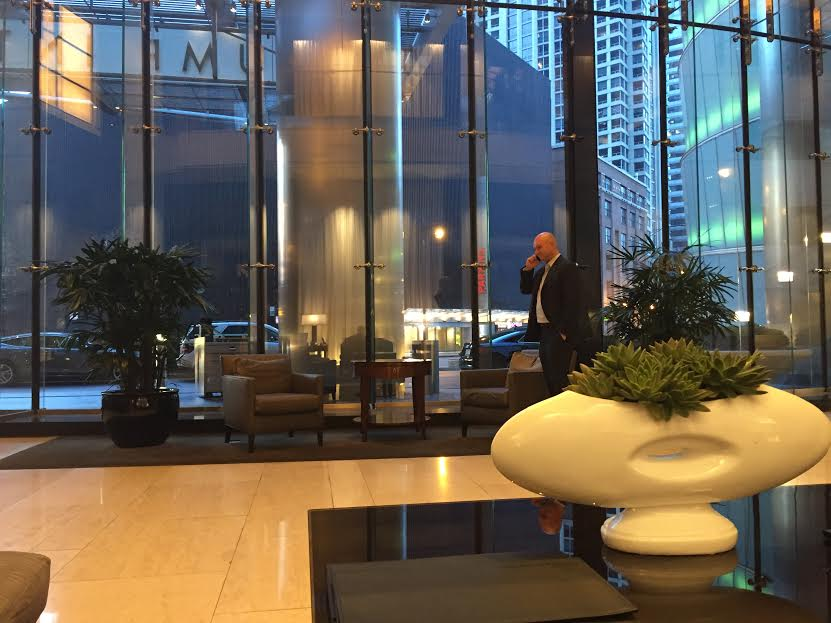 The Trump hotel was empty on Super Tuesday except for—of course—a suit on his phone.