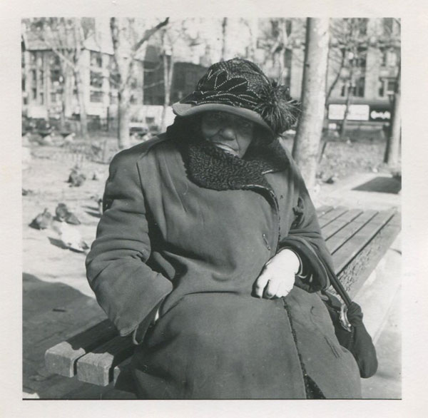 Vivian Maier's <i>Untitled (Woman in coat and hat on bench)</i>, another of the exhibit's photos from the collection of Ron Slattery
