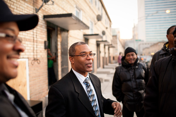 Burnett talking with constituents in front of the Cabrini-Green row houses where he grew up.