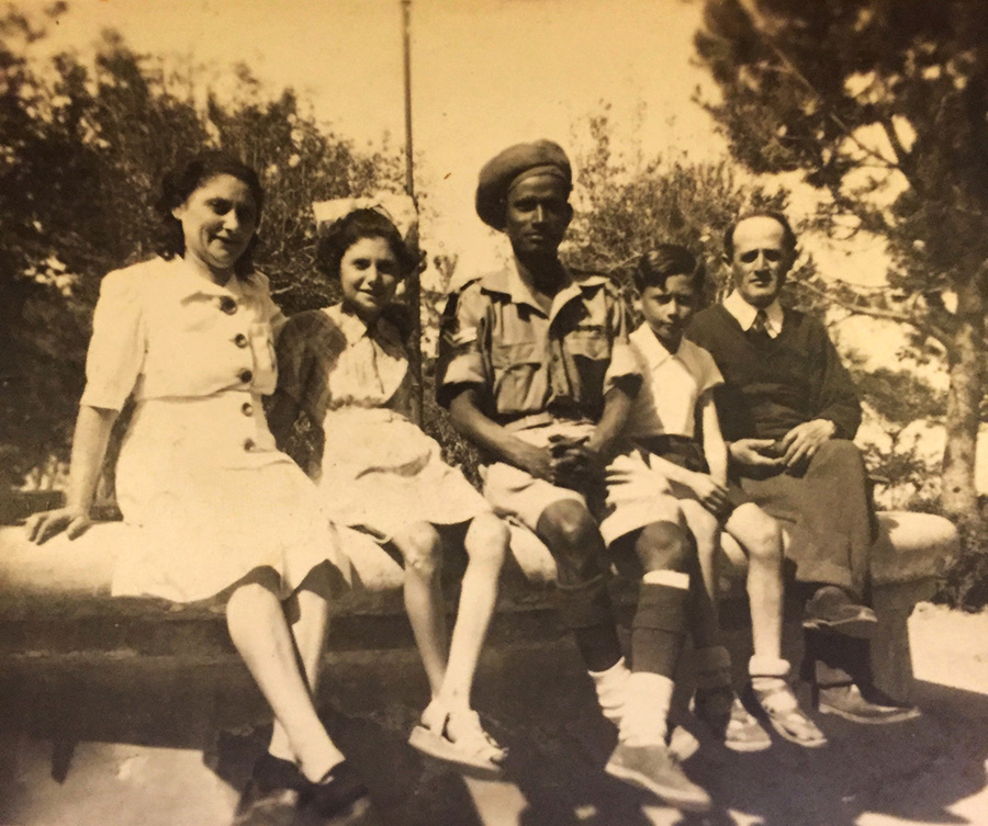 Rachel, Eugenia, Beno, and Isaac Weiss with an Indian soldier from the British army in Atessa, Italy, just after the Allied liberation of Italy.