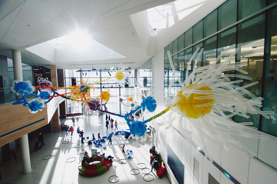 In 2012, Chyr and more than a dozen volunteers twisted together some 1,500 balloons to create his installation A Handful of Stardust inside the Calgary science museum Telus Spark.