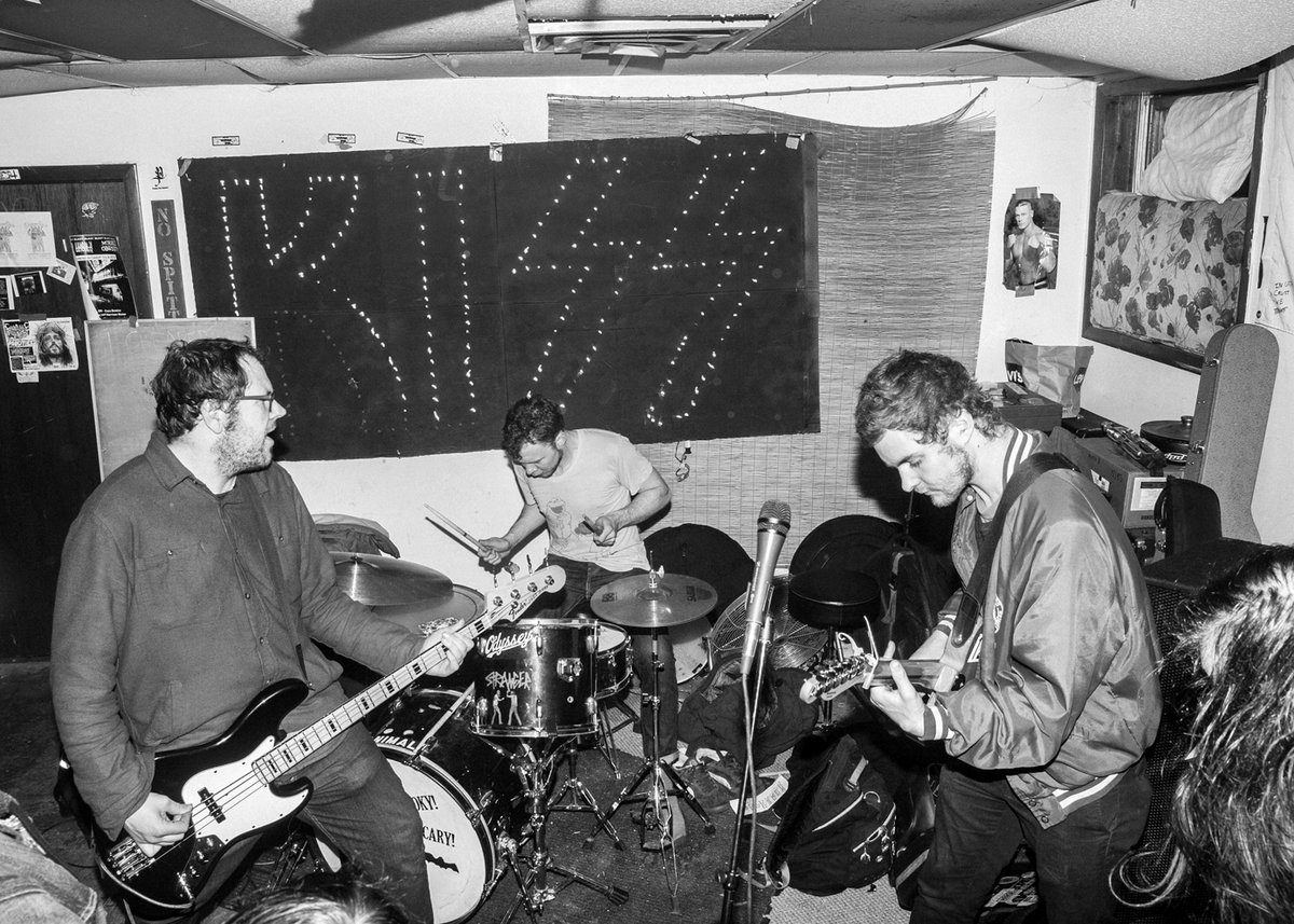 The band Meat Wave performing in a practice space