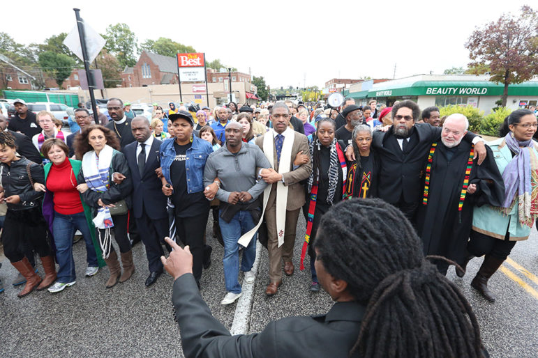 Rev. Osagyefo Sekou oversees a march from a local church to the Ferguson, MO, Police Department during Ferguson October Weekend of Resistance.