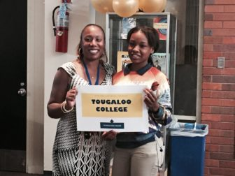 School counselor Lindsay Brown with senior Monica Tubbs on Hope College Prep's college decision day in May.