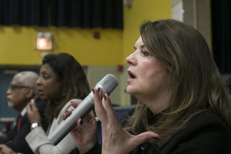 Kathryn Robbins, a member of the Illinois State Charter School Commission, asks the audience how many would experience a second school closure during a public hearing on Feb. 16 about the closure of Bronzeville Lighthouse Charter School.