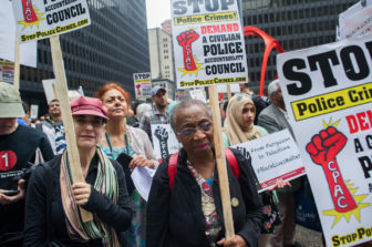 Chicagoans rally at Federal Plaza before the March for Community Control of Police on August 29, 2015.