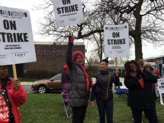 Shelagh Jackson pickets outside Mollison Elementary School in Bronzeville.