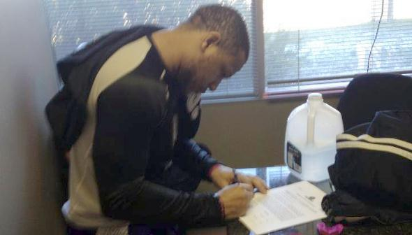 Kenny Booker signing Bellator contract, courtesy Suckerpunch Ent.