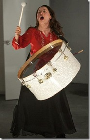 """Stacie Beth Green plays the big drum in TUTA Theatre Chicago's """"Fulton Street Sessions"""", directed by Zeljko Djukic. (photo credit: Anthony Lapenna)"""