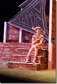 "Liam Dahlborn stars as Wilbur in Emerald City Theatre's ""Charlotte's Web,"" adapted by Joseph Robinette, directed by Ernie Nolan. (photo credit: Tom McGrath)"