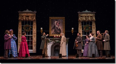 """Kareem Bandealy, Kim Schultz, Kristina Valada-Viars, Anish Jethmalani, Andrew Coil, Madeline Ruhl, Theo Allyn, Bret Tuomi  and Larry Neumann Jr. in Goodman Theatre's """"A Christmas Carol"""" by Charles Dickens, adapted by Tom Creamer, directed by Henry Wishcamper. (photo credit: Liz Lauren)"""