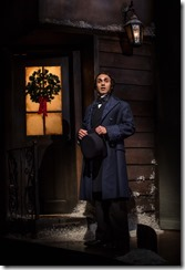 """Kareem Bandealy as The Narrator in Goodman Theatre's """"A Christmas Carol"""" by Charles Dickens, adapted by Tom Creamer, directed by Henry Wishcamper. (photo credit: Liz Lauren)"""