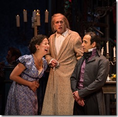 """Kristina Valada-Viars, Larry Yando and Kareem Bandealy in Goodman Theatre's """"A Christmas Carol"""" by Charles Dickens, adapted by Tom Creamer, directed by Henry Wishcamper. (photo credit: Liz Lauren)"""