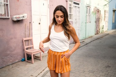 Model in the streek with orange skirt from Protest Boardwear