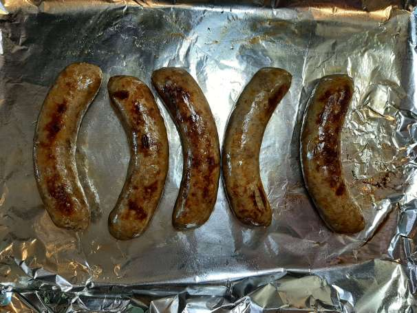 browned Italian sausage on greased aluminum foil lined jelly roll pan