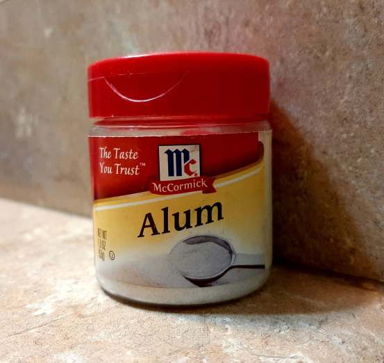 container of alum on a counter