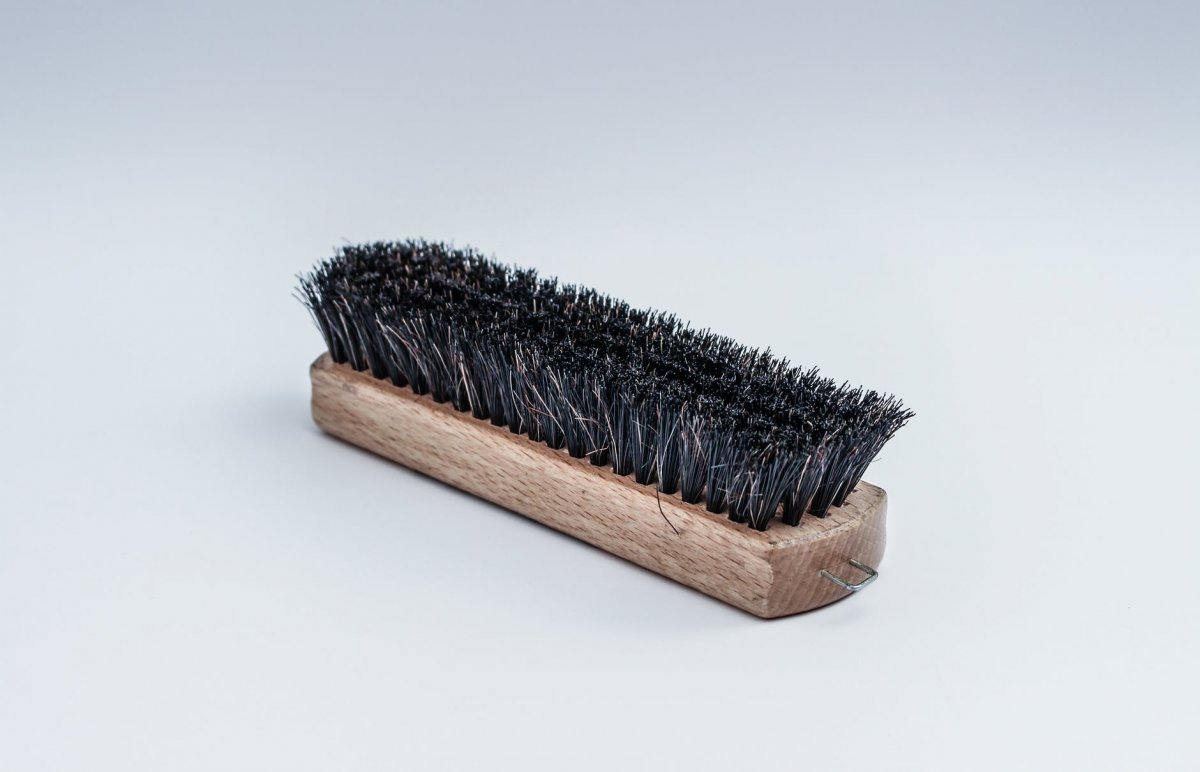 black steel brush for the best way to clean a chicken coop