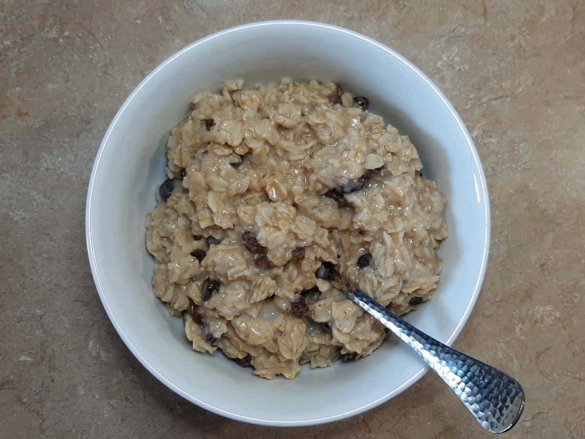 oatmeal with raisins in white bowl