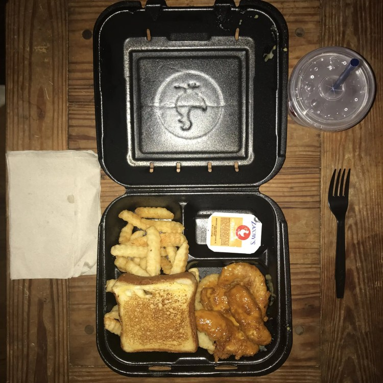 Zaxby's Hot Honey Mustard, crinkle fries, water, Texas Toast, Zax Sauce, and fork to-go