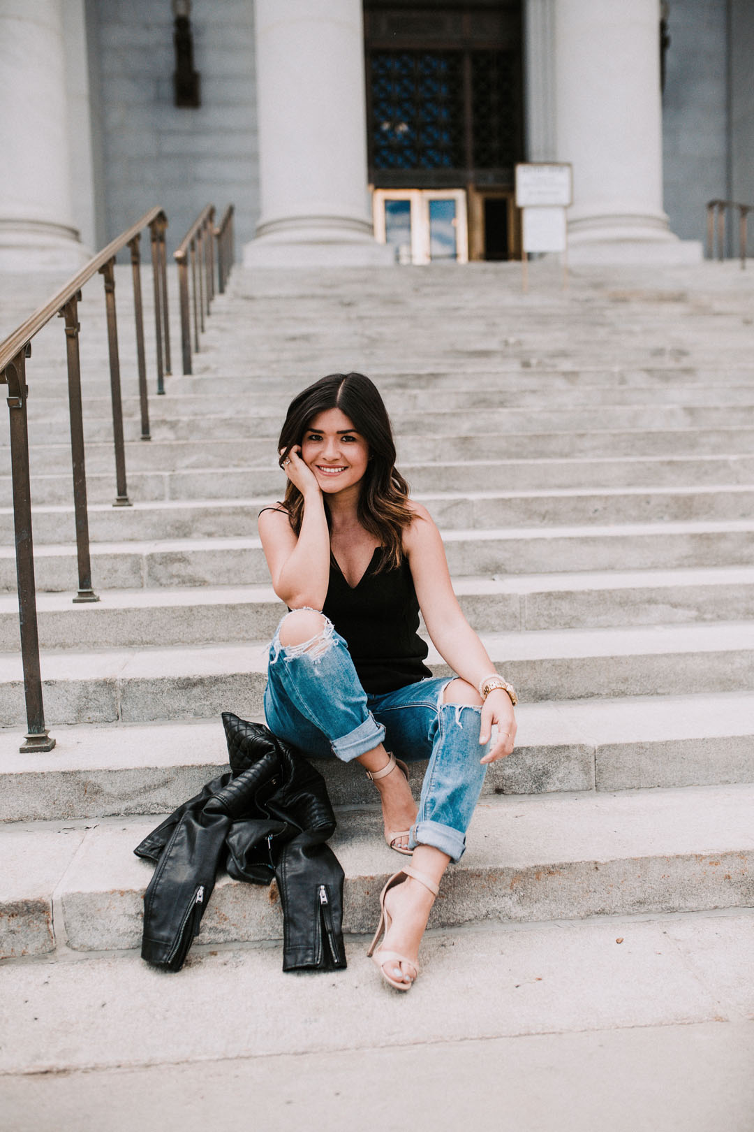Carolina Hellal of Chic Talk wearing American Eagle tomgirl jeans, Bailey44 black top, and Topshop black faux leather jacket