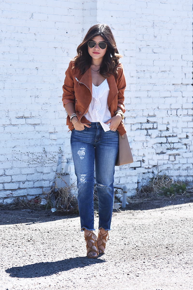 suaede jacket and ripped jeans look