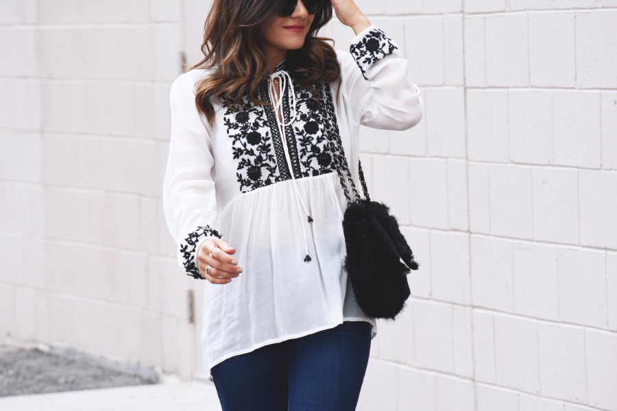 White top with black embroidered flowers