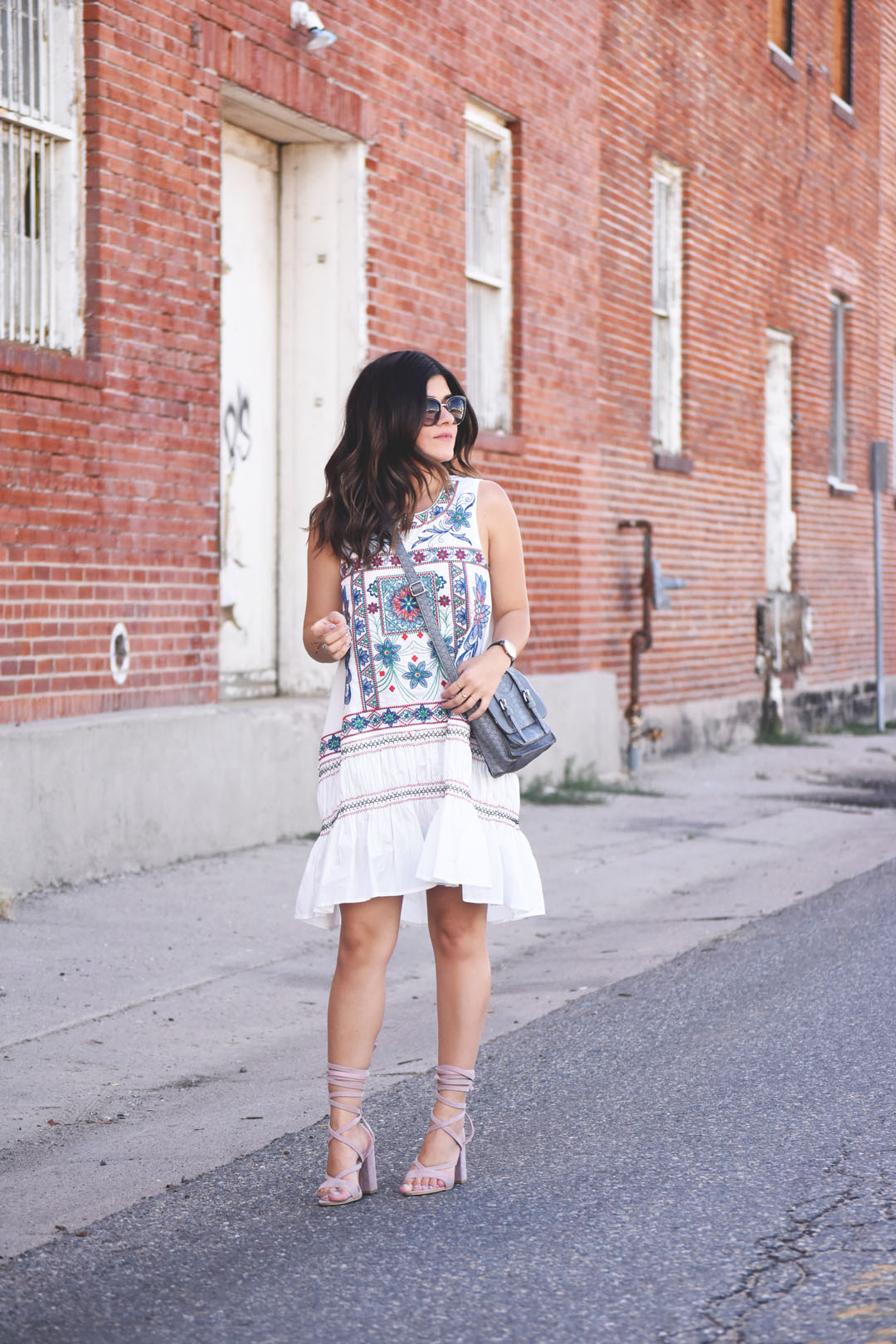 Carolina Hellal of Chic Talk wearing a Chicwish white summer dress and Public Desire light pink lace up sandals