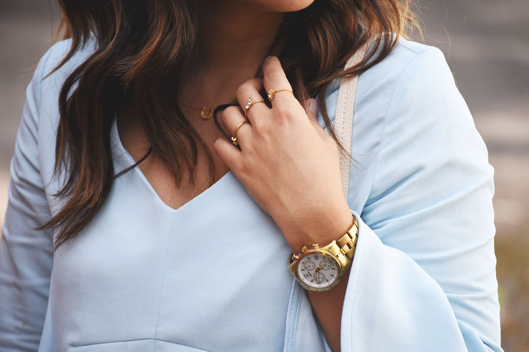 Carolina Hellal of Chic Talk wearing a Timex gold watch, Gorjana gold necklace and Pueblo L.A dainty gold rings