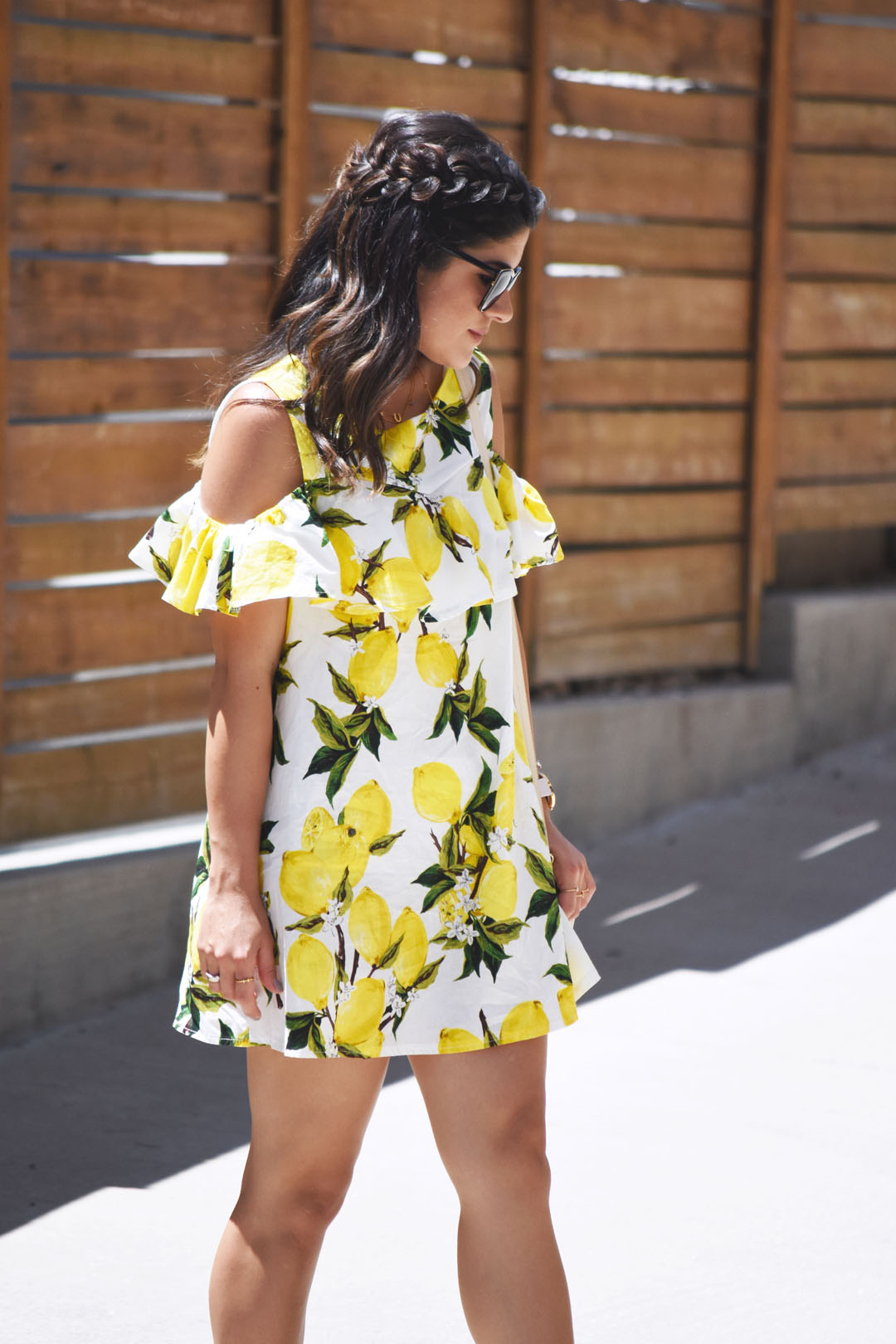 Carolina Hellal of Chic Talk wearing a lemon printed dress via Romwe, Nordstrom sunglasses, and Pueblo L.A gold rings