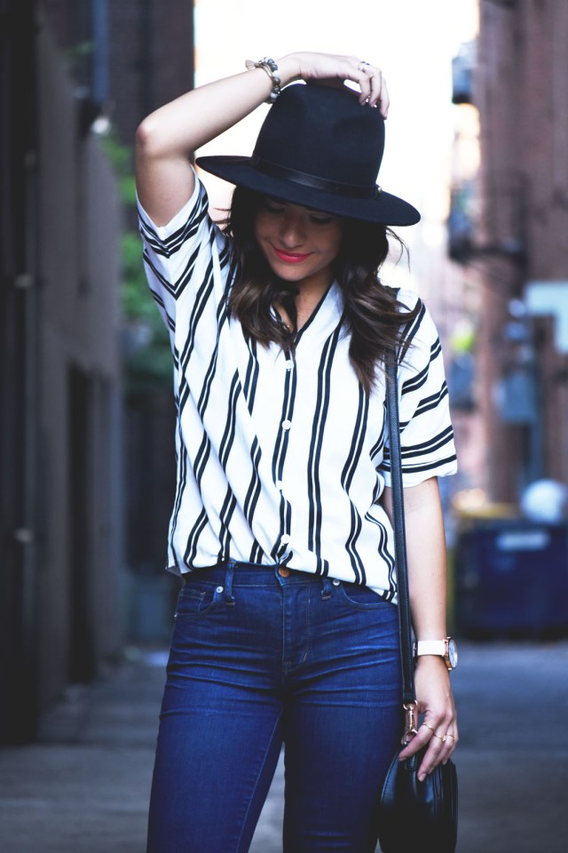Carolina Hellal of Chic Talk wearing a Romwe stripe top, Madewell skinny dark wash jeans and Forerver21 black wool hat