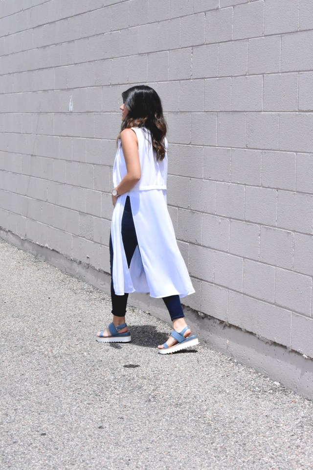 Carolina Hellal of Chic Talk wearing an Ibis jeans white vest, american eagle jeans and skechers sandals