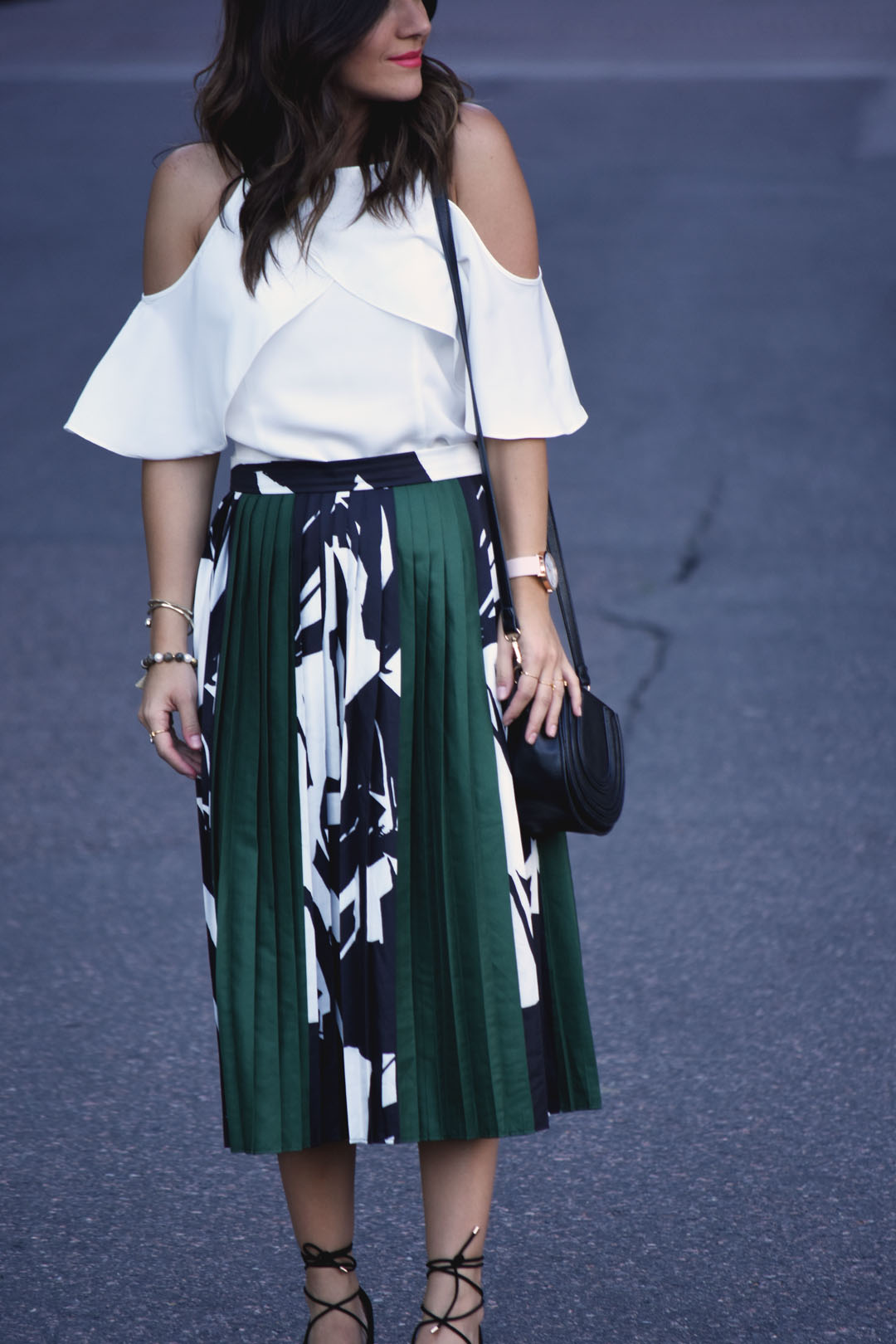 Carolina Hellal of Chicwish cold shoulder top, printed pleated midi skirt, and Mellow World fashion body crossbag