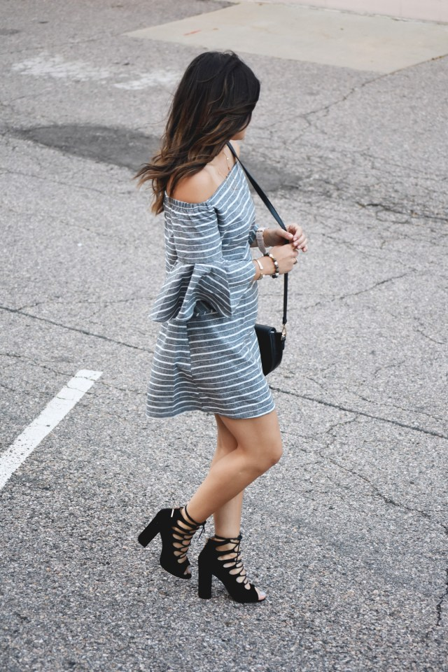 Carolina Hellal of Chic Talk wearing a Chicwish off the shoulder dress, Public desire black lace up sandals, and Christian Paul watch.