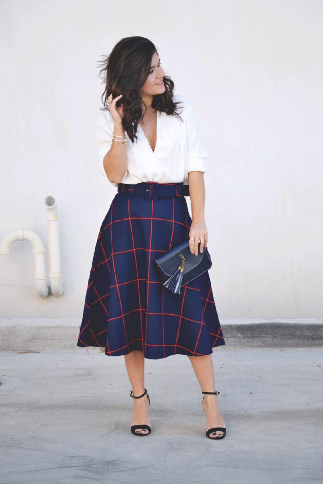 Carolina Hellal of Chic Talk wearing a plaid midi skirt via Chicwish.