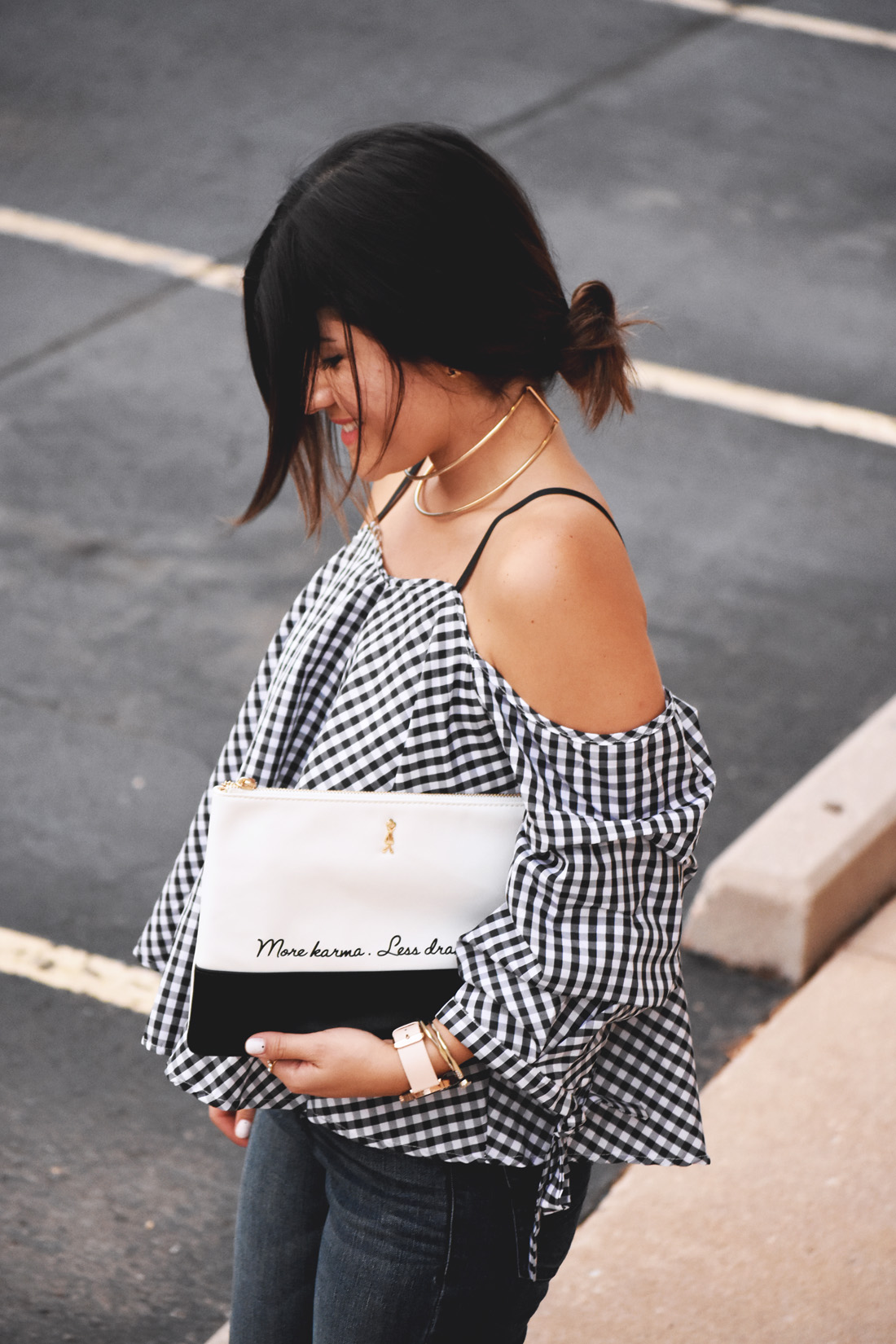 Carolina Hellal of Chic Talk wearing a chicwish gingham off the shoulder top, and le motto black and white clutch