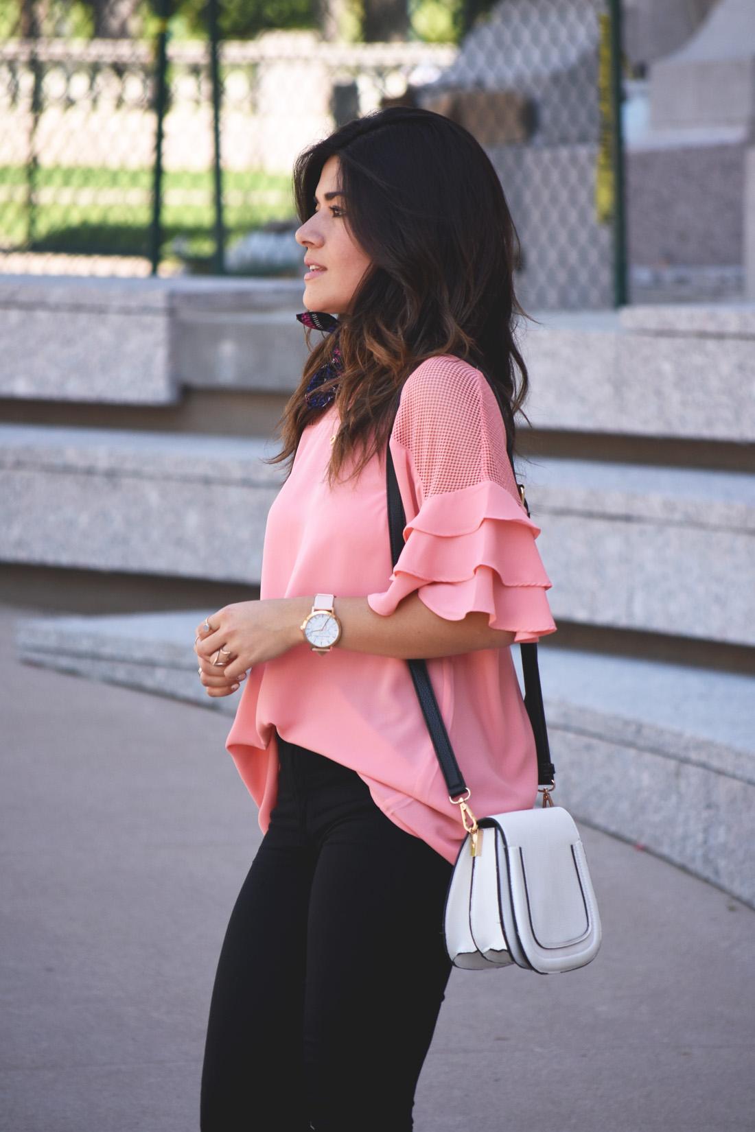 Carolina Hellal of Chic Talk wearing a VIPme pink top, Christian Paul watch, and solesociety bag.
