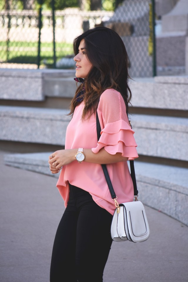 Carolina Hellal of Chic Talk wearing a VIPme pink top, Christian Paul watch, and solesociety bag.