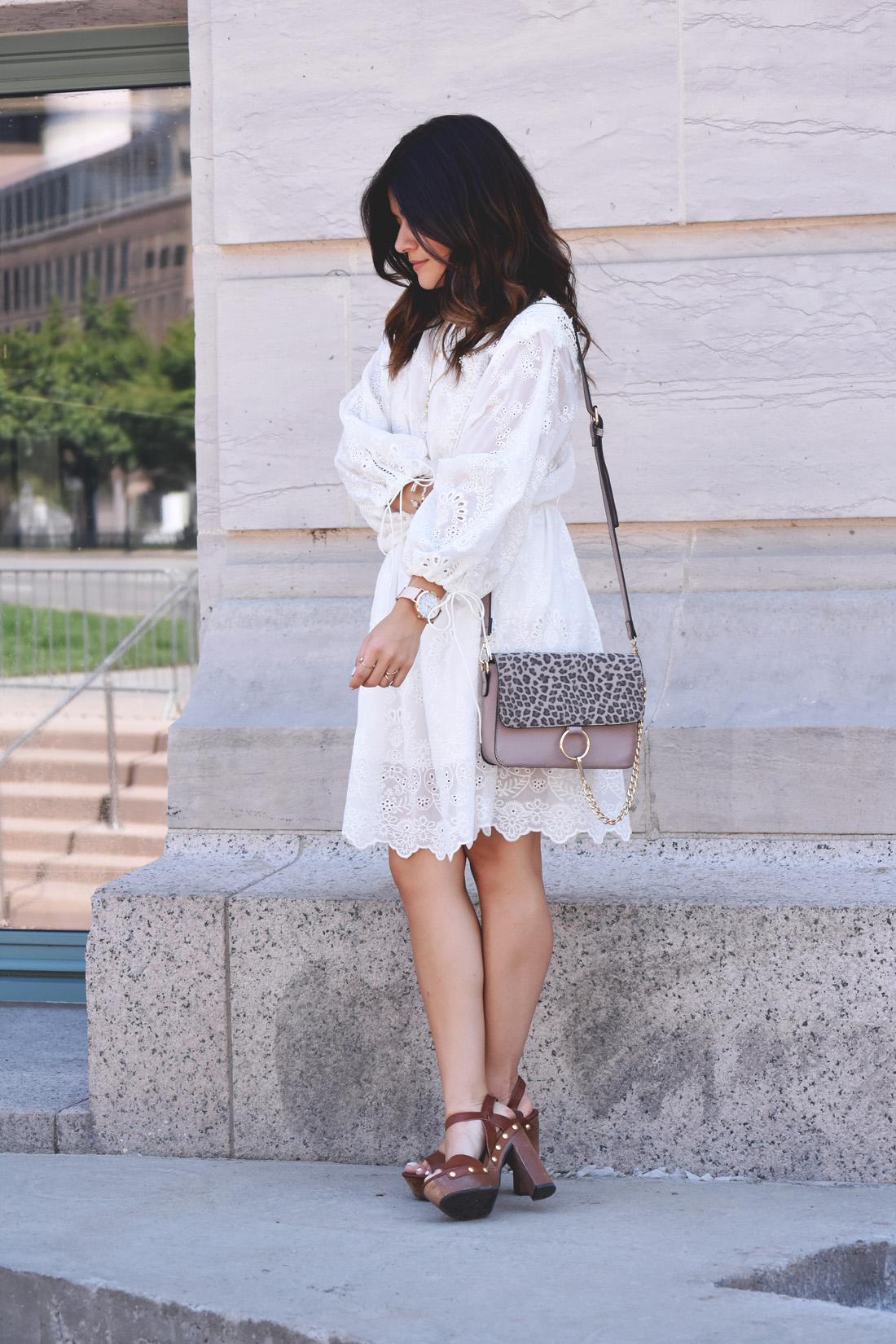 Carolina Hellal of Chic Talk wearing a VIPME white summer dress, wodden platforms and a gray mellow handbag world crossbody bag.