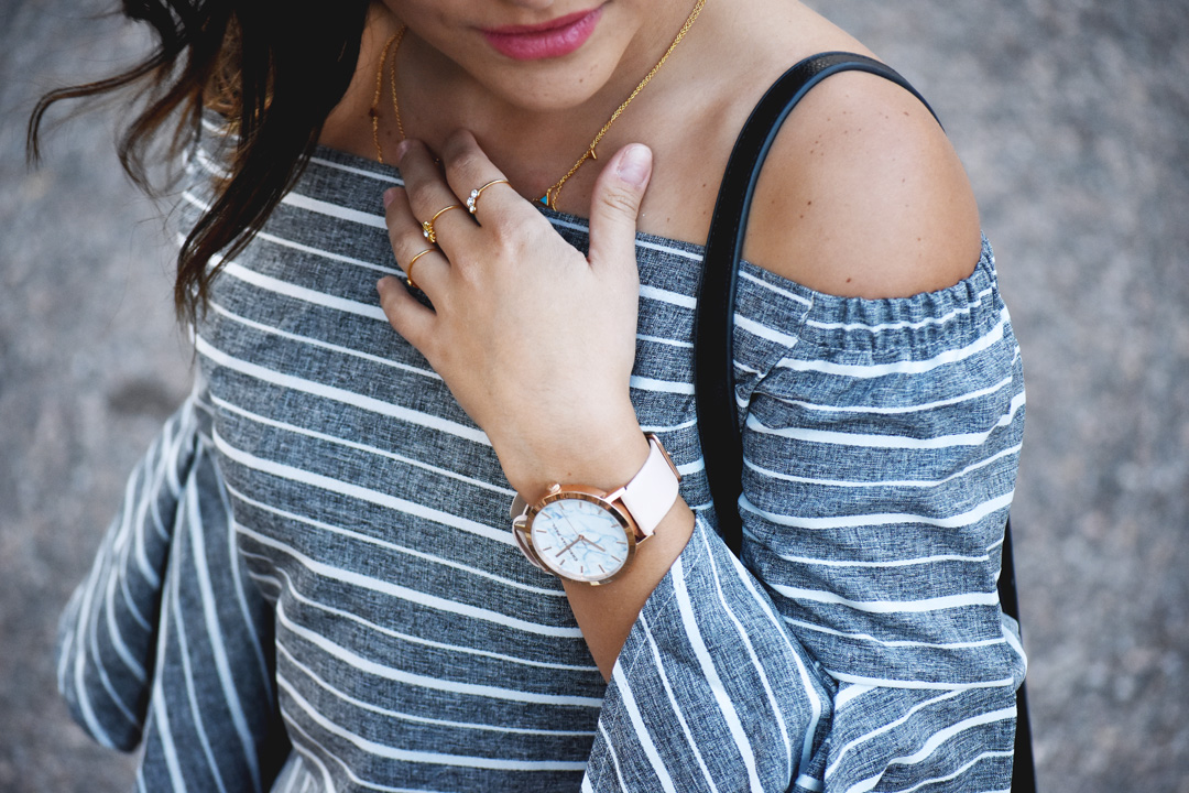 Gorjana dainty necklace, Christian Paul watch, and Pueblo L.A gold rings.