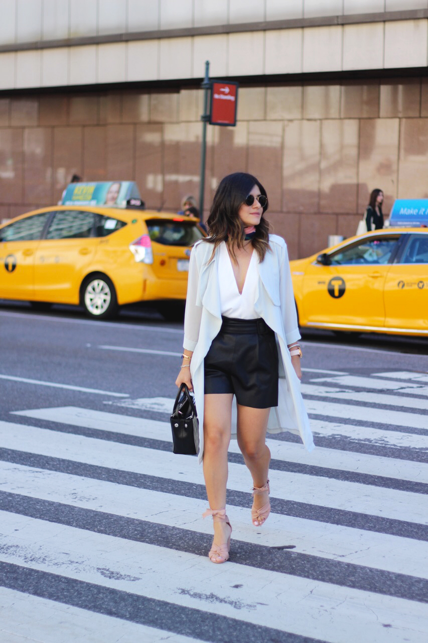 Carolina Hellal of Chic Talk wearing a Chicwish cardigan, Zara faux leather top, Tobi white top, Topshop blush lace up sandals, h&m printed scarf, and Rayban 50mm rounded sunglasses.