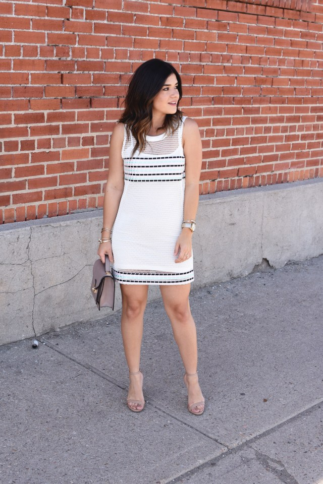 Carolina Hellal of chic Talk wearing a Tobi mesh dress, Steve Madden nude strap sandals, and Timex gold watch