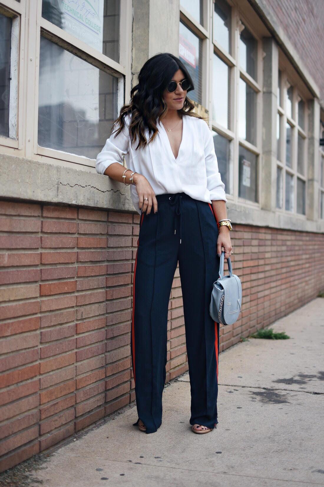 Carolina Hellal of the fashion blog chic talk wearing H&M navy blue track pants
