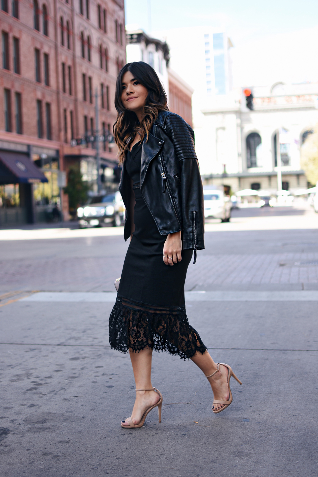 Carolina Hellal of Chic Talk wearing a total black look with a Chicwish dress and Topshop faux leather jacket