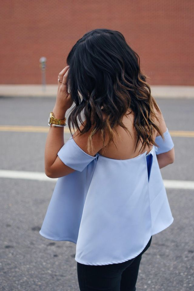 Carolina Hellal of Chic Talk wearing a Chicwish a strapless top, Madewell jeans, and Gold timex watch