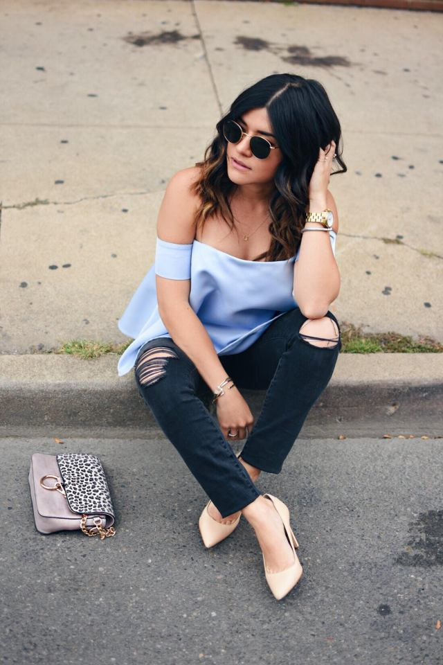 Carolina Hellal of Chic Talk wearing a chicwish blue strapless top, Rayban sunglasses, madewelll jeans, Sam Edelman nude pumps