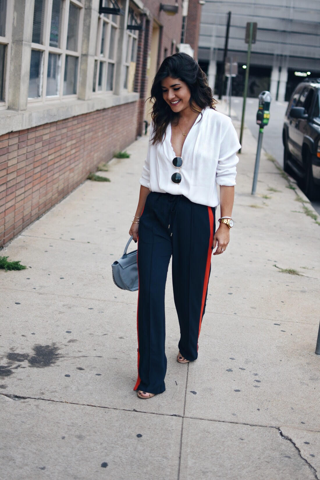 Carolina Hellal of Chic Talk wearing H&M navy blue track pants, white cross front blouse and Rayban Rounded 50mm sunglasses