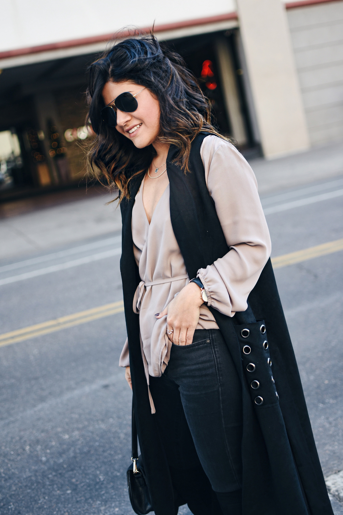 Carolina Hellal of Chic Talk wearing a VIPme black long vest, Forever21 top, Over the knee boots, and Rayban sunglasses